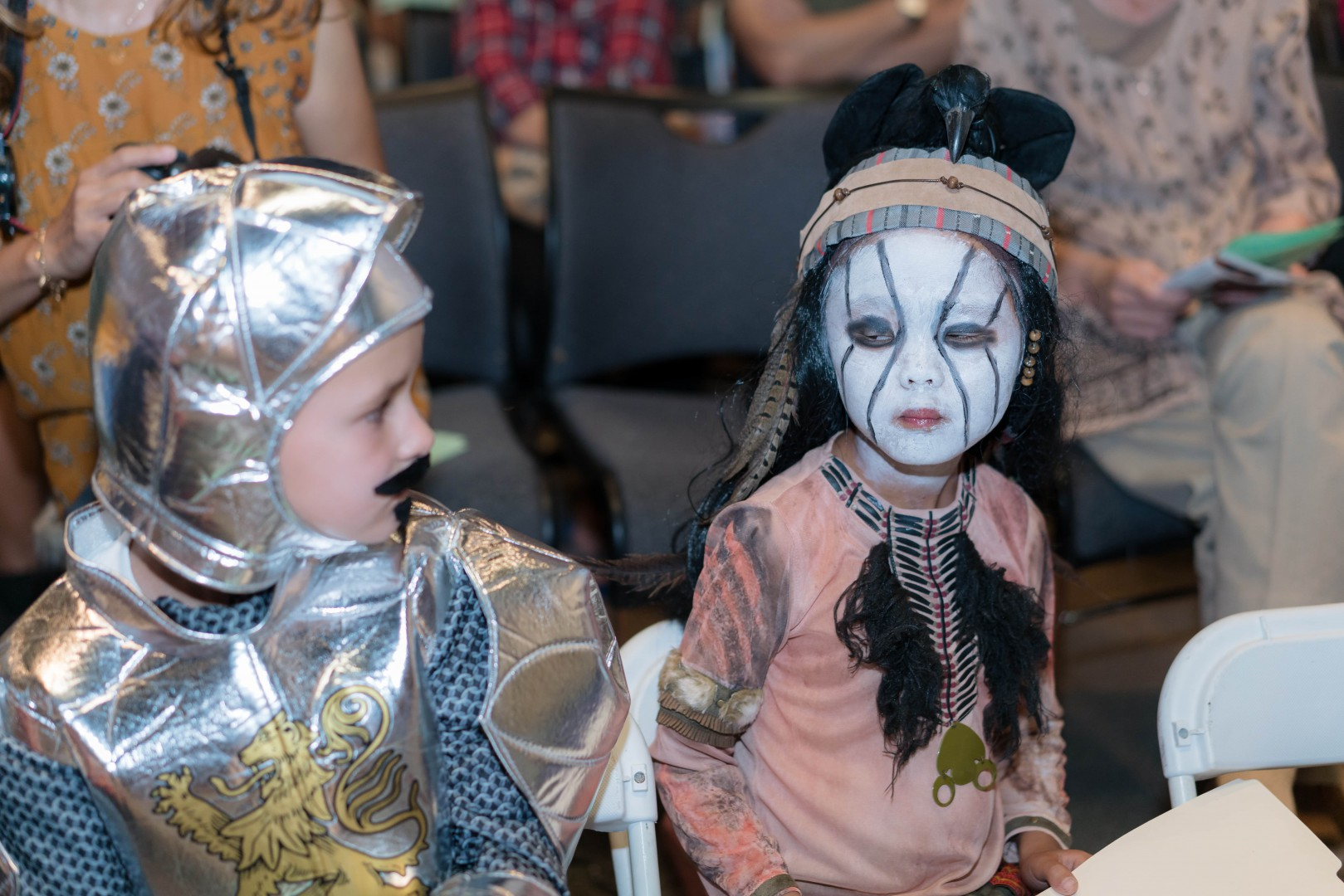 Two young children wearing their costume