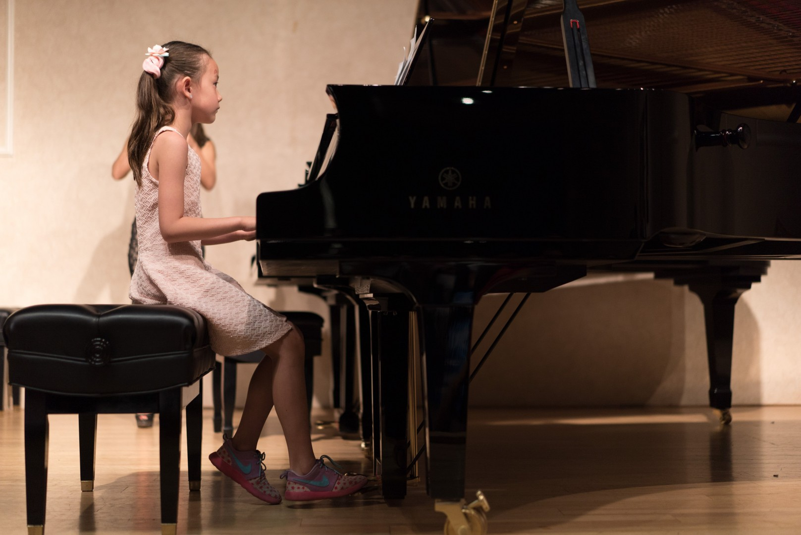 Litle girl playing the piano
