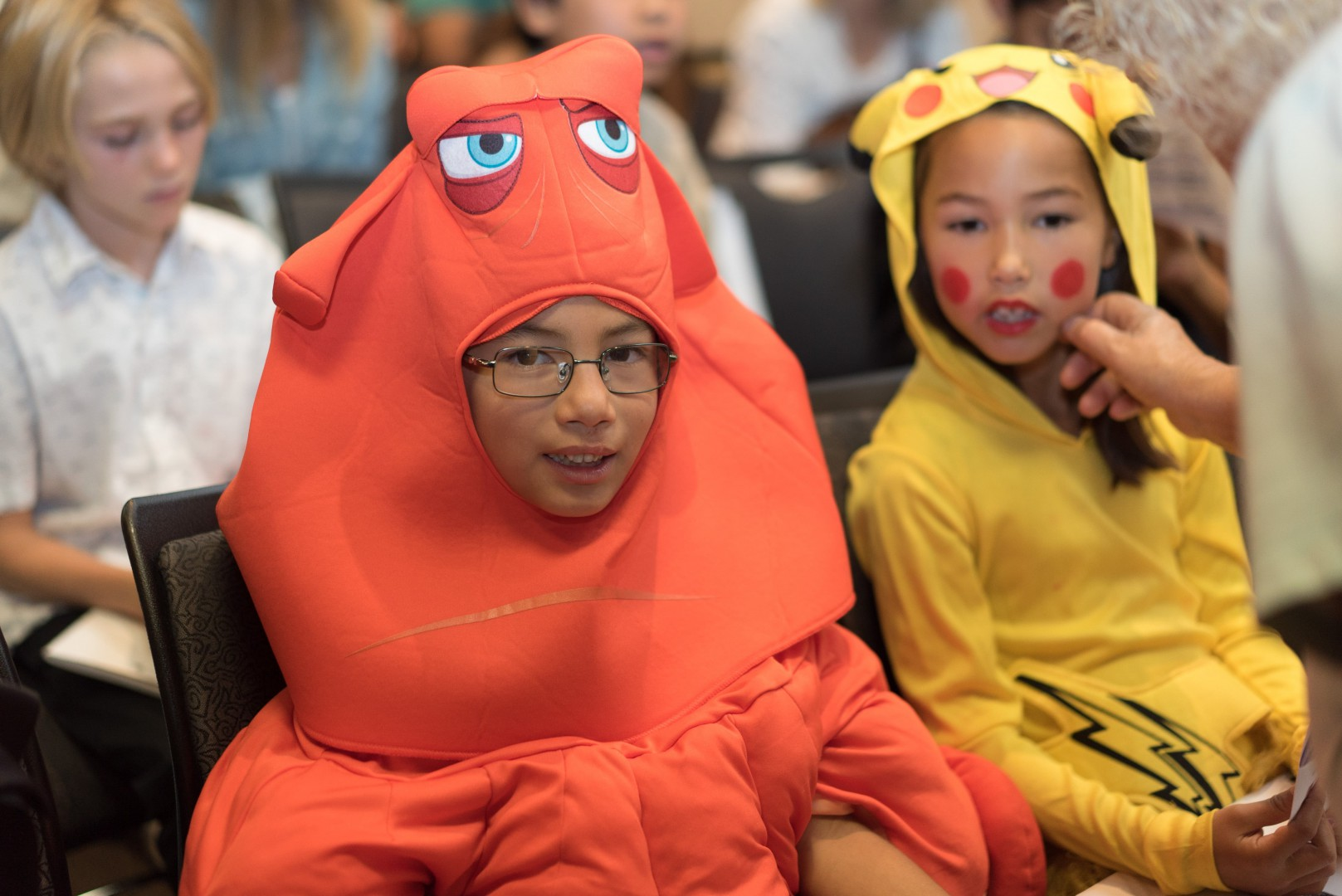 Two young girls in cartoon character costume