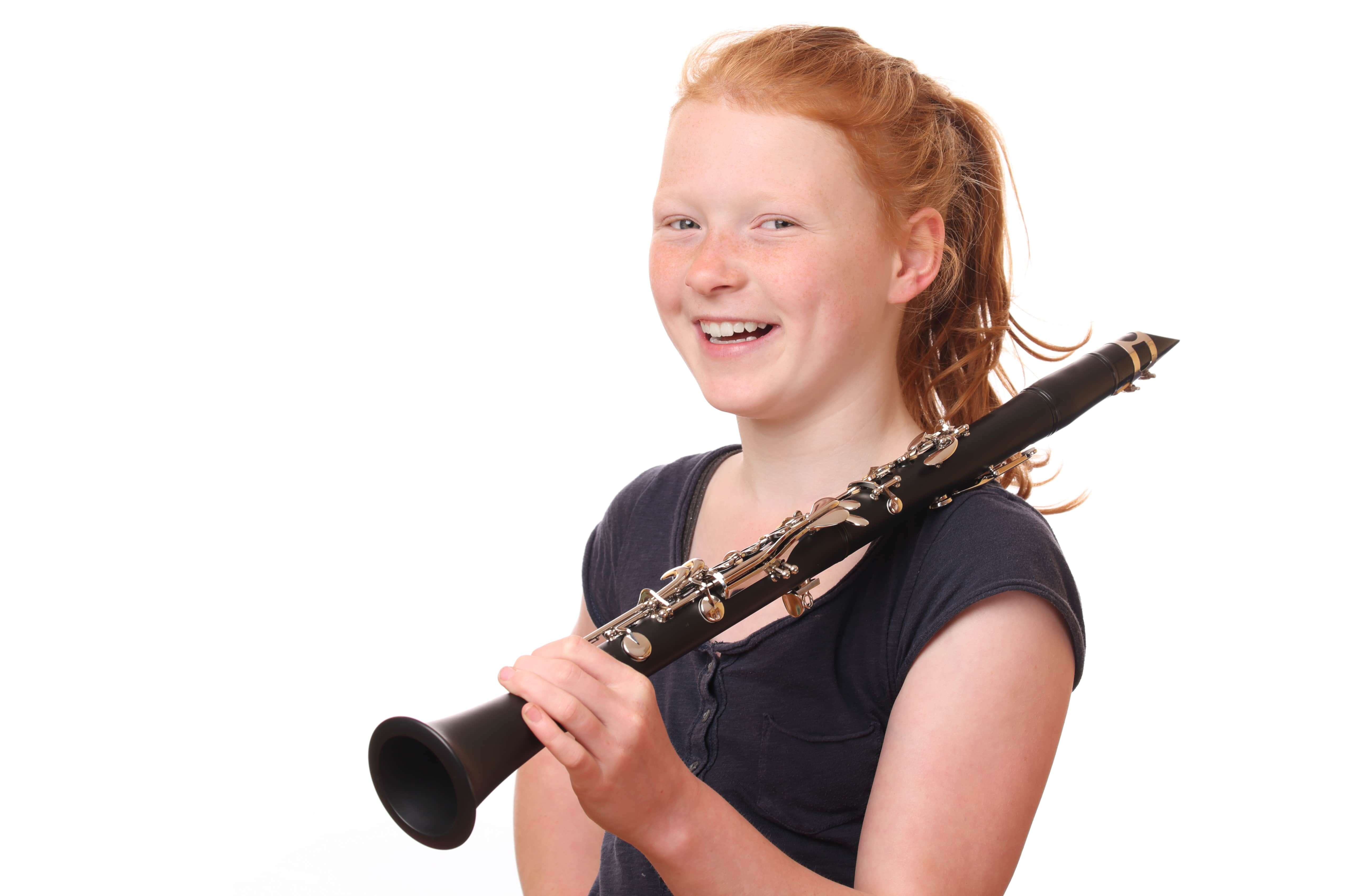 Student smiling while playing Clarinet
