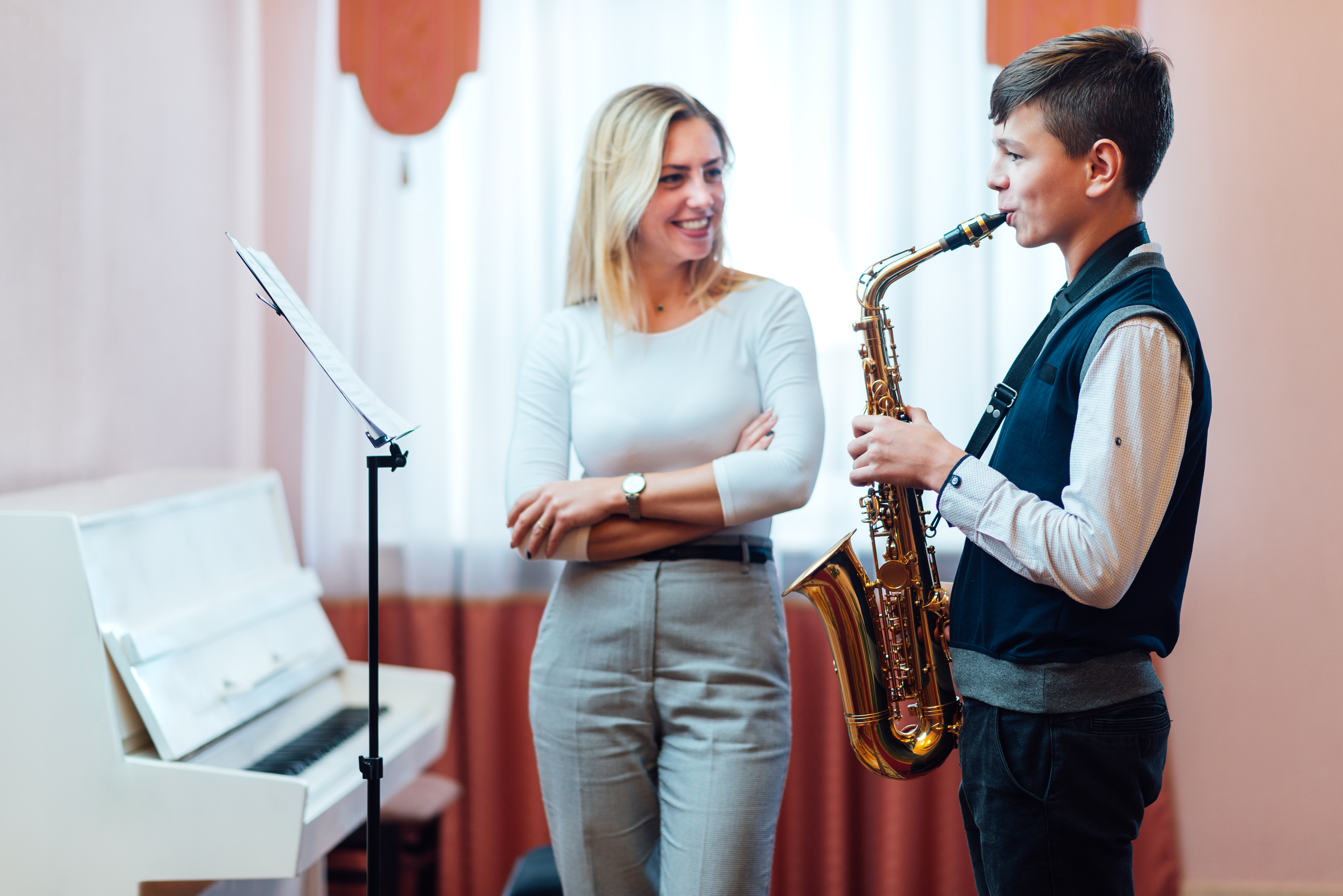 Instructor teaching her student Saxophone lessons