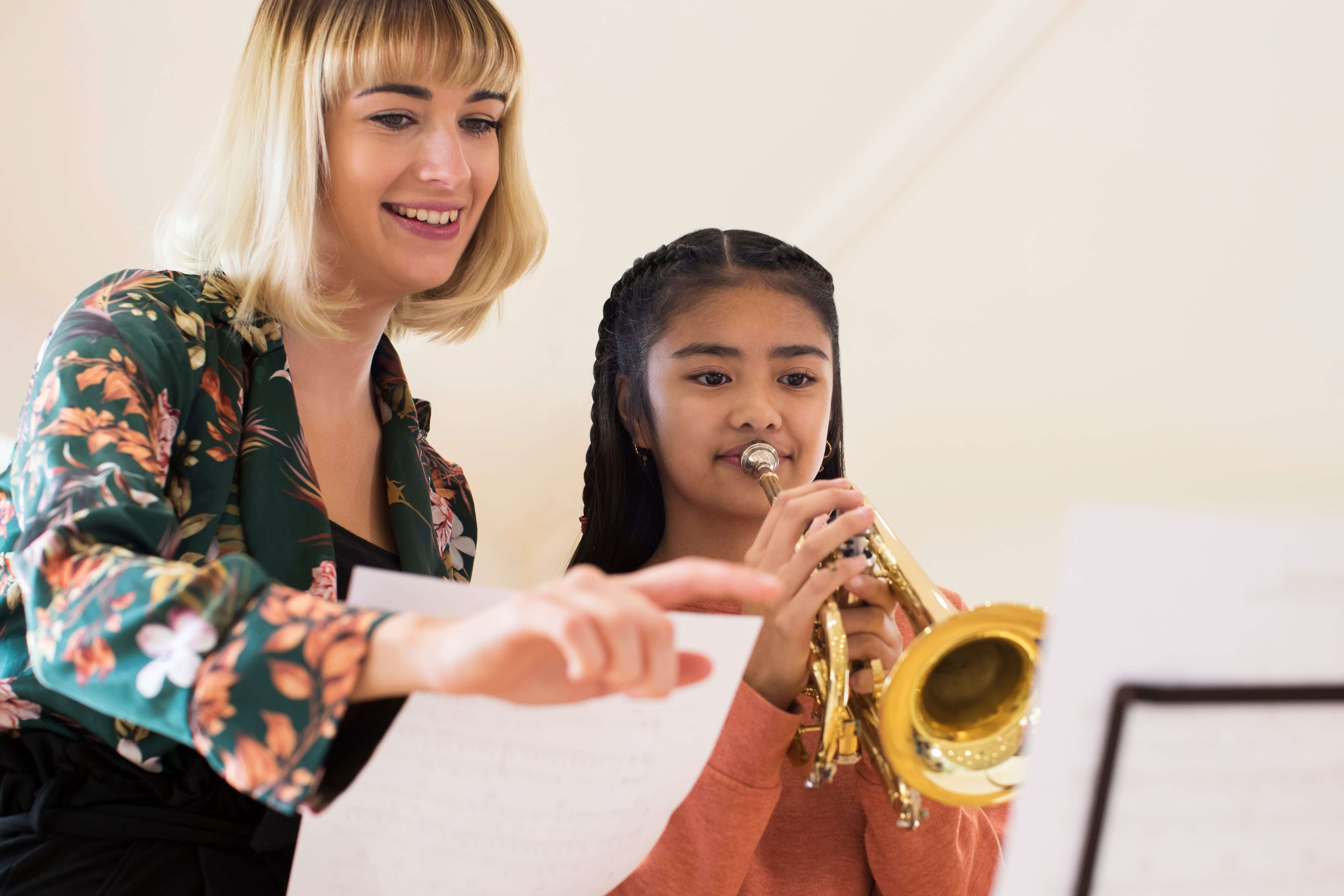 Instructor teaching her student Trumpet lessons